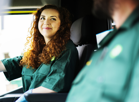 Paramedic woman driving an ambulance