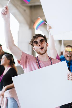 Cheerful gay man at a pride festival