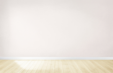 Light pink wall in an empty room with a wooden floor
