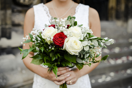Bride with a bouquet of roses