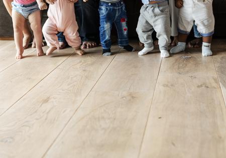 Babies walking on a wooden floor
