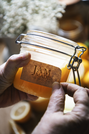 Putting a label on a jar of jam