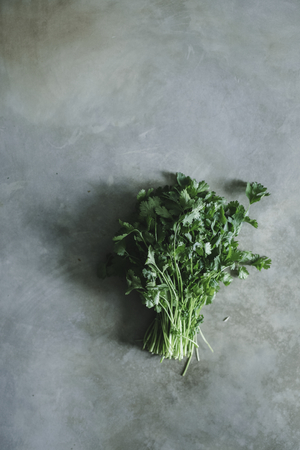 Bunch of cilantro on a concrete table