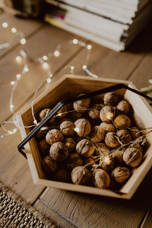 Walnuts in a wooden basket on a wooden floor Stock Photo