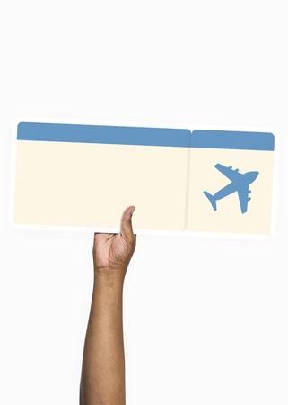 Hand holding a flight ticket Stok Fotoğraf