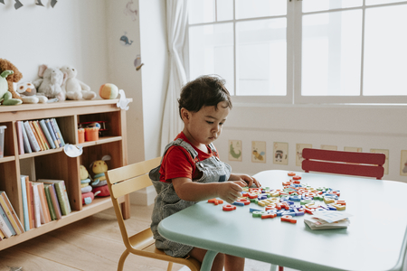Young kid playing with educational toys Stock Photo