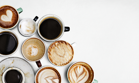 Assorted coffee cups on a white background
