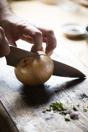 Onion being cut for cooking Stok Fotoğraf