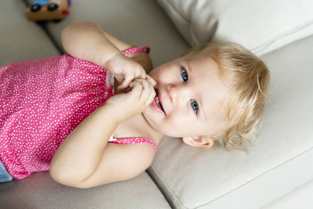 Closeup of a baby lying down Stock Photo