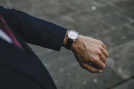Businessman checking the time on his watch Stock Photo