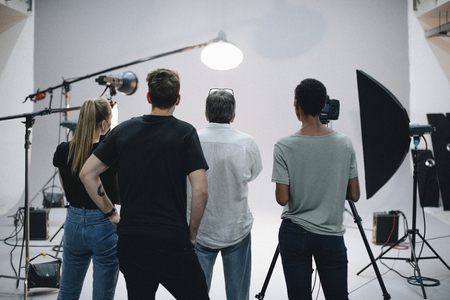 Production team working together in a studio Stok Fotoğraf