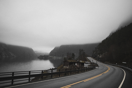 View of a misty road near the fjord in Norway Banco de Imagens