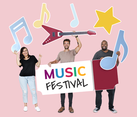 Happy diverse people holding music festival icons Stock Photo