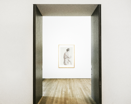Hallway doors opening to framed art on a wall