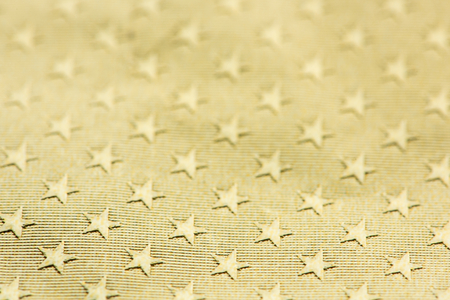 Shiny gold textured star patterned paper background