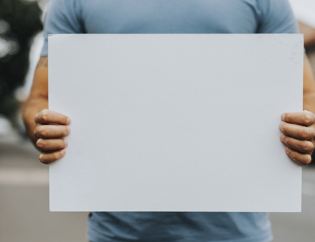 Person showing a blank board to support a movement