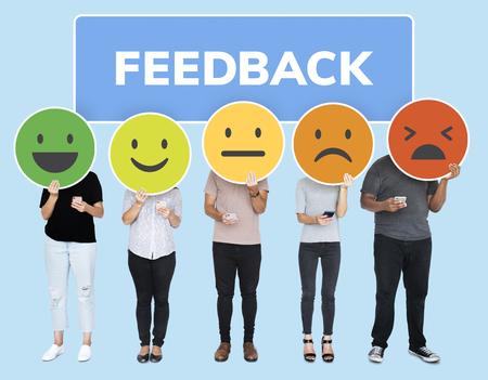 People showing customer feedback evaluation emoticons Stockfoto