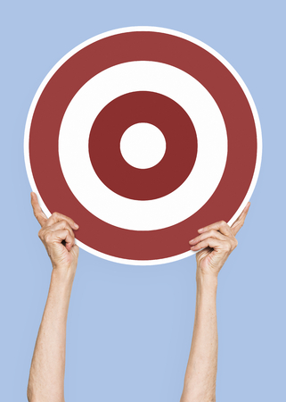 Hand holding a target icon clipart