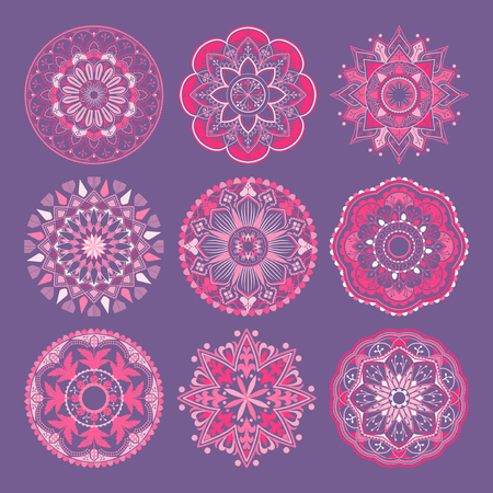 Pink mandala patterns set on purple background Archivio Fotografico - 116995192
