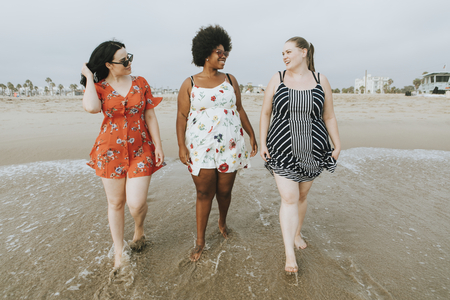 Curvy women at the beach Stock Photo