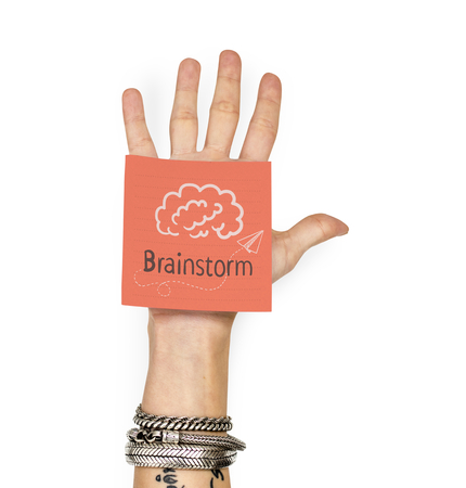 Hand showing a sticky note with Brainstorm