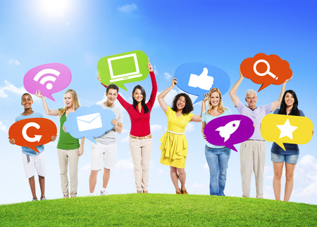 Diverse Multi-Ethnic People Outdoors Holding Social Network Related Speech Bubbles