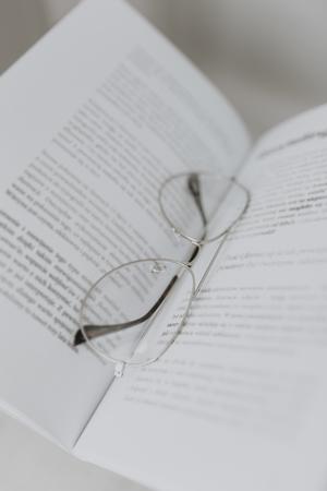 Eyeglasses on an open textbook