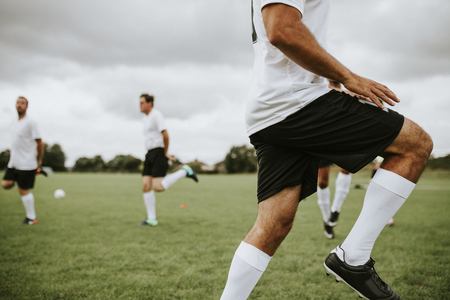 Football players training on the field Stock Photo