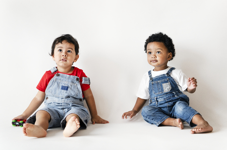 Two little boys sitting studio shot