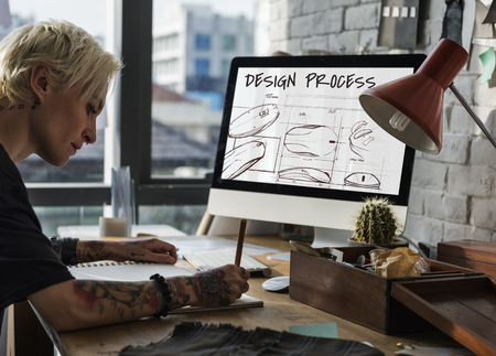 Woman designing a digital mouse