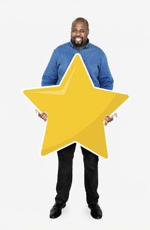 Businessman showing golden star rating symbol