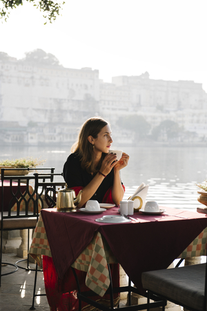 Western woman having a teatime at a cafe in Udaipur Stock Photo - 117112127