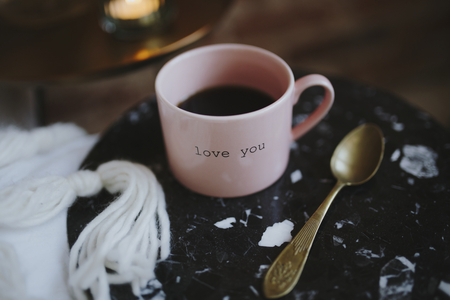 Hot black coffee in a pink cup