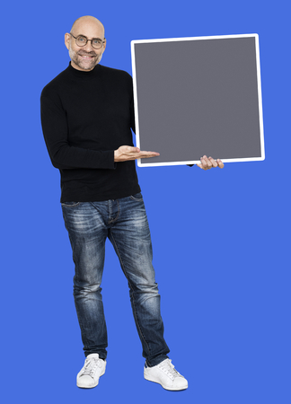 Man holding up a blank board