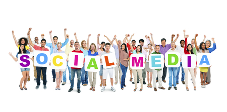 Multi-Ethnic Group of Diverse People Holding Letters To Form A Word Social Media