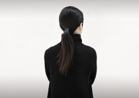 Rear view of an Asian woman 免版税图像