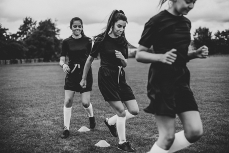 Female football players training on the field Stock Photo