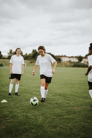 Female football players playing a game