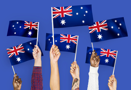 Hands waving the flags of Australia
