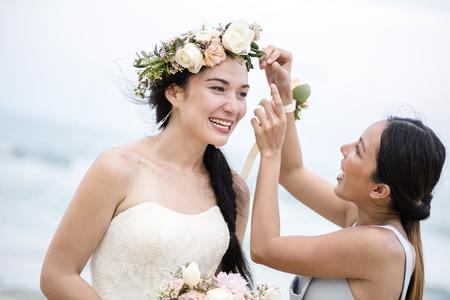 Cheerful bride at the beach Standard-Bild - 117602176