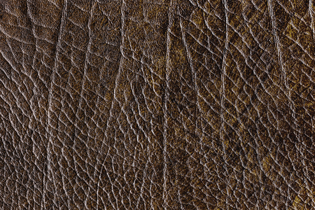 Brown creased leather textured background