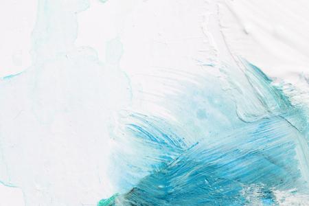 Fond texturé de traits de peinture à l'huile blanche et bleue