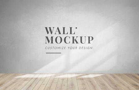 Empty room with a gray wall mockup Фото со стока