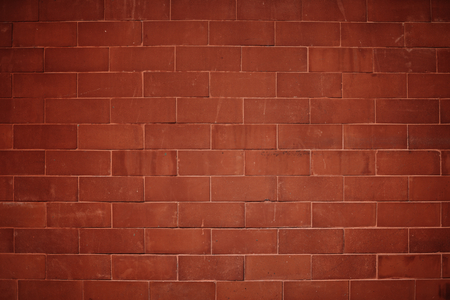 Reddish orange brick wall textured background