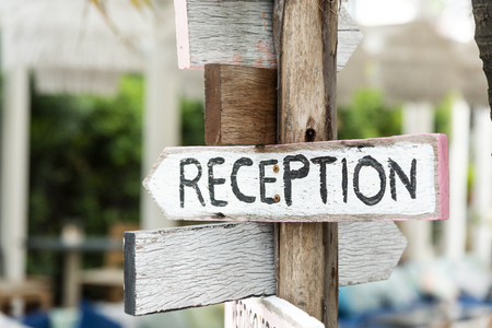 Wooden direction signage to reception