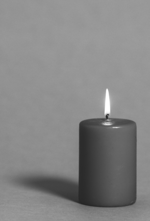 Black and white burning candle