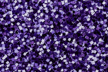 Shiny purple sequins textured background