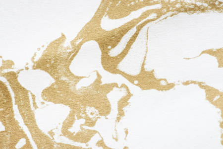 White and gold fluid art marbling paint textured background