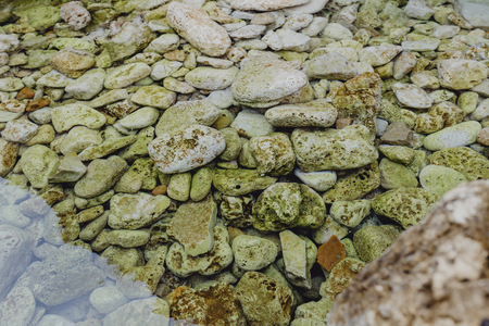 Pebbles under clear still waters Banco de Imagens