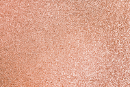 Close up of peach glitter textured background